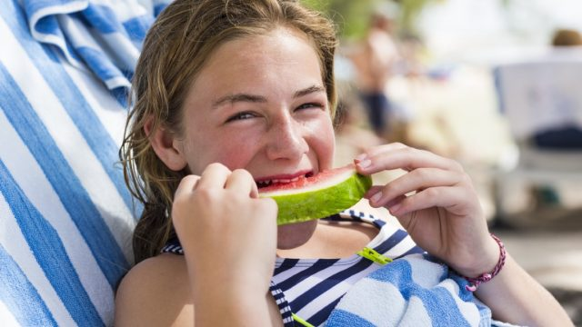 13 year old girl eating watermelon