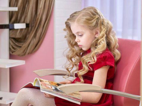 little-girl-reading-a-magazine-PMR29RN