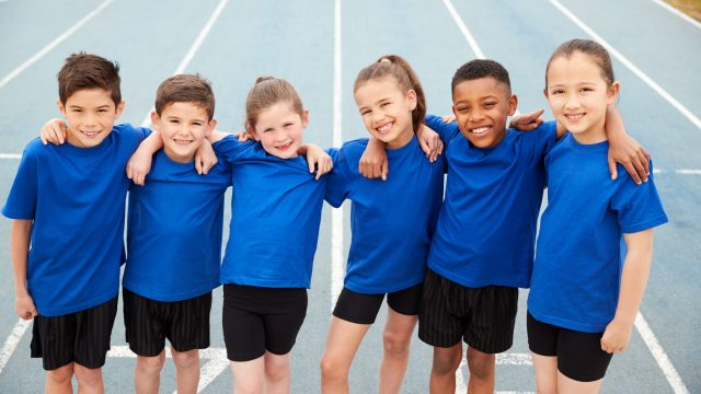 Portrait Of Children In Athletics Team On Track On Sports Day